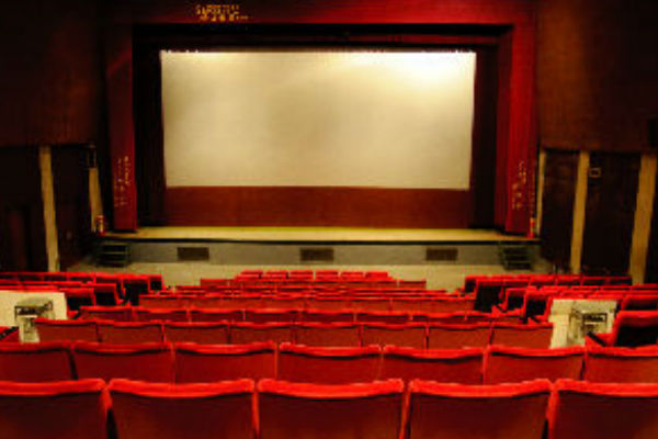 Afbeelding van een bioscoopzaal. Organiseer in de winter een filmavond voor jouw Run for KiKa